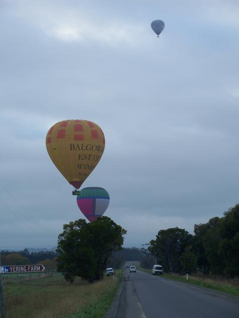 Balloons on approach with ground crew standing by