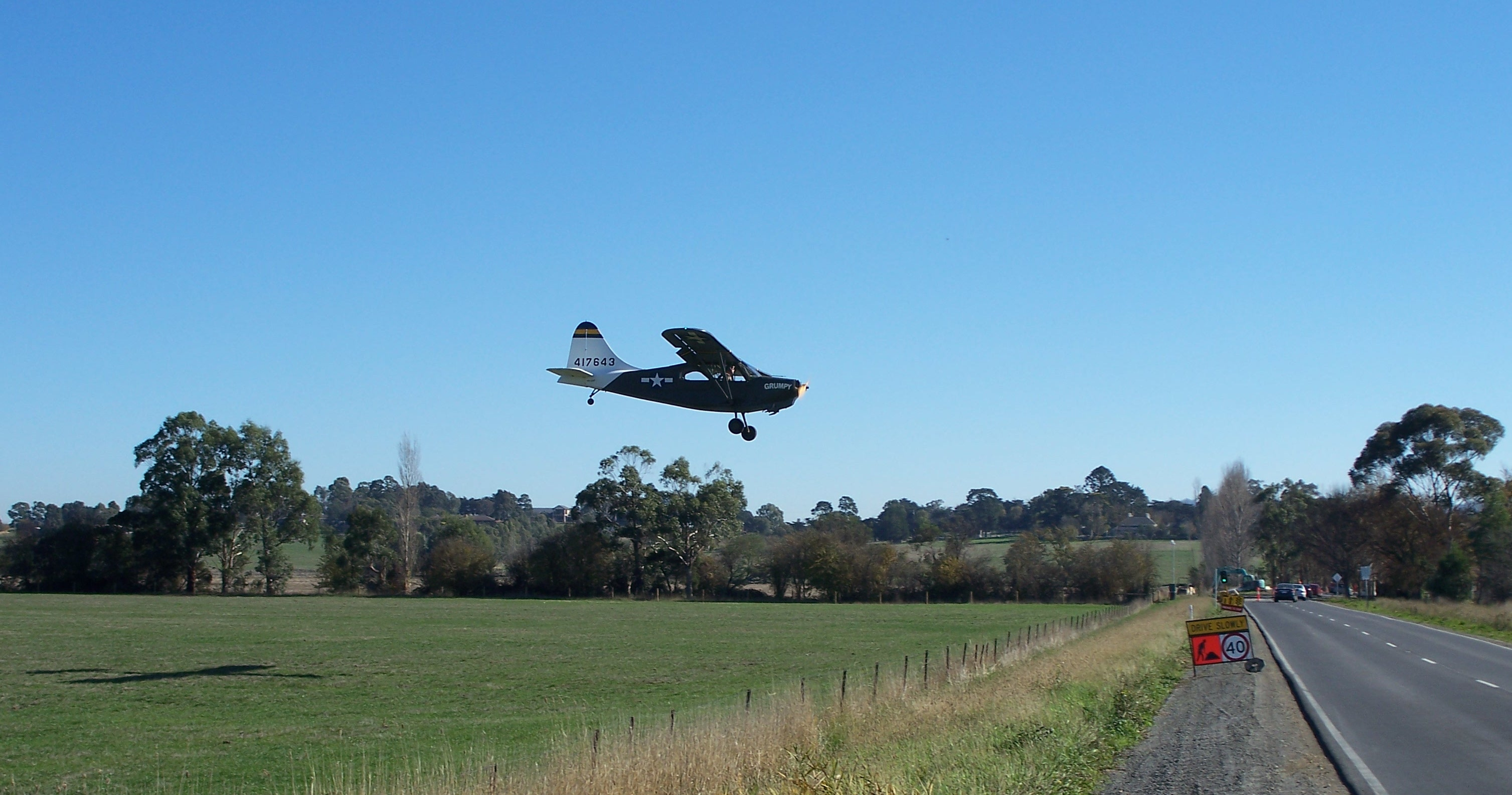 VH-CDF Stinson L5B on very short finals